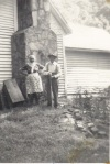 Bessie and Fletch outside their house